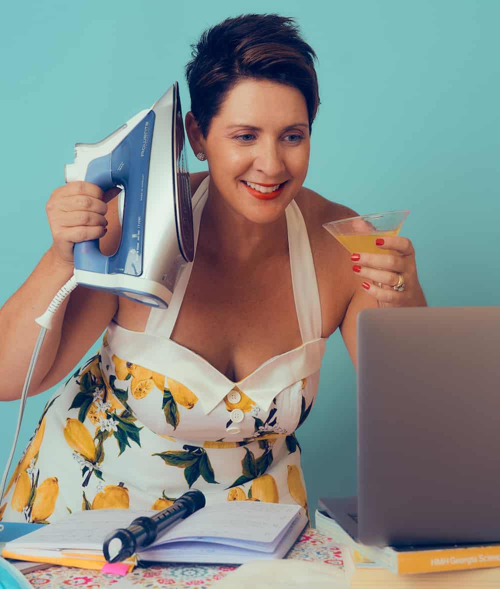 Heather ironing and laptop